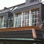 Balkon mit Edelstahlgeländer und Glasfüllungen