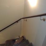 Holztreppe mit Edelstahl Details